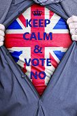 stock photo of voting  - A British businessman rips open his shirt and states for voters to vote no in the 2014 vote for Scottish independance - JPG