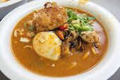 image of malay  - Mee Rebus Malay Local Noodle Dish with Hard Boiled Egg Fried Tofu Cut Chili Peppers and Potato Cake - JPG