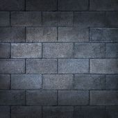 stock photo of cinder block  - Concrete block wall or weathered cinderblock background with a blank rough rustic cement surface texture as a backdrop of an urban building detail with copy space - JPG