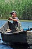 Fisherman In A Boat In The Danube Delta, Romania