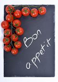 Bon Appetit On A Blackboard With Tomatoes