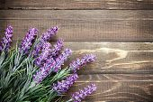 stock photo of bouquet  - Lavender flowers on a vintage wooden background - JPG