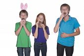 pic of niece  - three young children eating and stuffing their mouths with marshmallow chocolate easter eggs - JPG