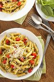 stock photo of pesto sauce  - Light Homemade Pesto Pasta with Parmesan and Tomatoes - JPG