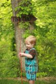 stock photo of fishing rod  - Close focus on a toddler holding a bamboo fishing pole with a  - JPG