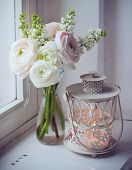 image of buttercup  - Home festive decorations elegant bouquet of flowers buttercups and white lilac and candle lantern on white vintage windowsill - JPG