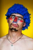 Clown in a blue wig