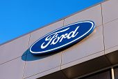 Samara, Russia - November 24, 2013: The Emblem Ford On The Office Of Official Dealer. Ford Motor Com