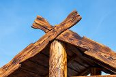 stock photo of gable-roof  - Detail of wooden roof gable over blue sky - JPG