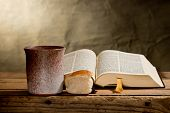 image of chalice  - still life with Bible chalice and bread
