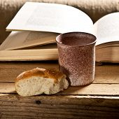 stock photo of chalice  - still life with Bible chalice and bread