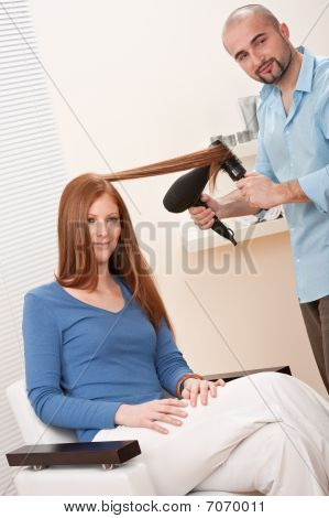 Professional Hairdresser With Hair Dryer At Salon