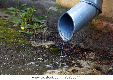 downspout on the street