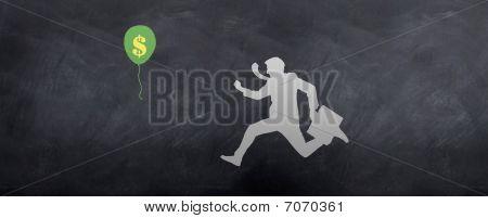 Business Man Chasing Dollar Balloon