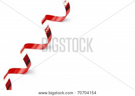 red confetti serpentine ribbon isolated on white