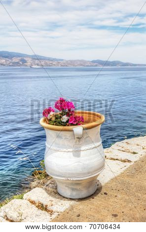 Flower Pot Over Aegean Sea In Hydra, Greece