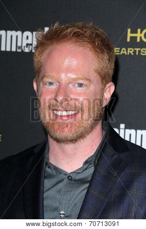 LOS ANGELES - AUG 23:  Jesse Tyler Ferguson at the 2014 Entertainment Weekly Pre-Emmy Party at Fig & Olive on August 23, 2014 in West Hollywood, CA
