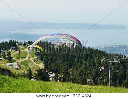 A Tandem Paraglider takes off from Grouse Mountain, Vancouver