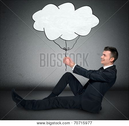 Business man holding cloud sketch