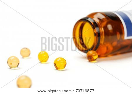 Yellow pills with bottle, isoated