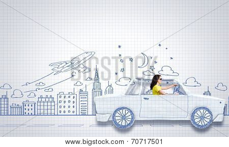 Young woman riding car made of list of paper
