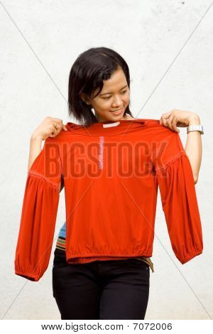 Young Woman Fitting Clothes