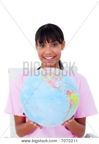 Portrait Of An Attractive Female Doctor Holding A Terrestrial Globe