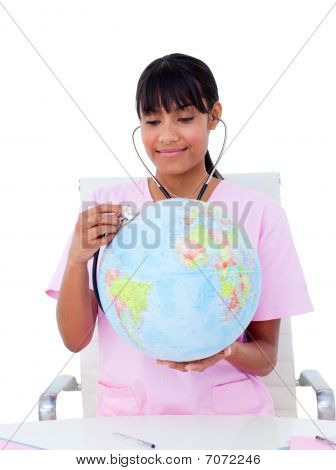 Portrait Of A Female Doctor Examining A Terrestrial Globe