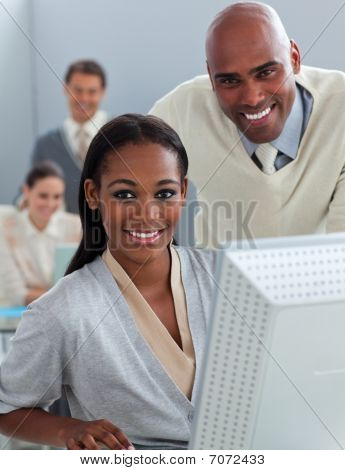 Portrait Of Two Businesspeople Working At A Computer
