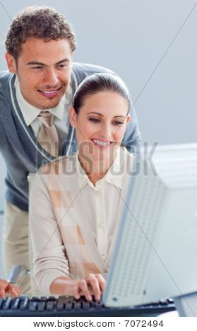 Pretty Businesswoman And Her Manager Working At A Computer