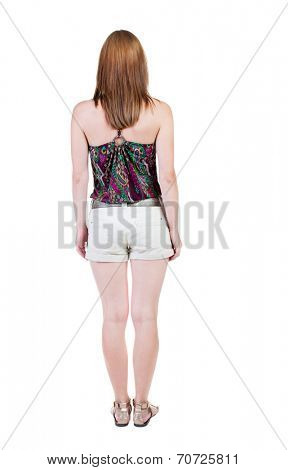 back view of standing young beautiful  brunette woman in shorts. girl  watching. Rear view people collection.  backside view of person.  Isolated over white background.