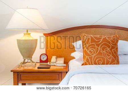 King Sized Bed With Thai Silk Pillow, Lamp, Clock, Telephone In A Hotel Thailand