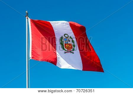 Peruvian Flag in the peruvian Andes at Puno Peru