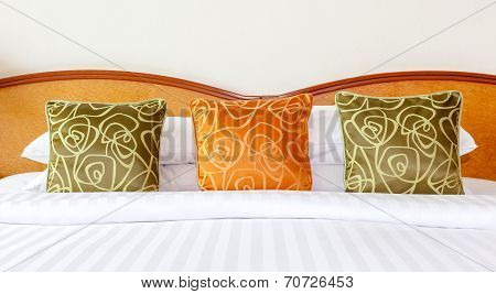 Hotel Room Setting With King Sized Bed, Thai Silk Orange And Green Pillows