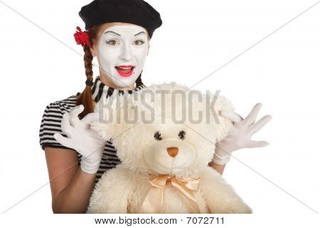 Mime Comedian Playing With Teddy Bear
