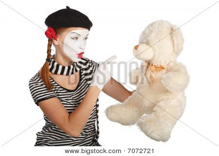 Mime Comedian Talking With Teddy Bear