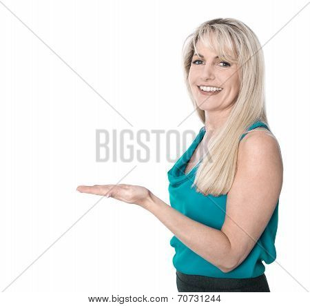 Attractive Middle Aged Woman Presenting With Palm Isolated Over White.