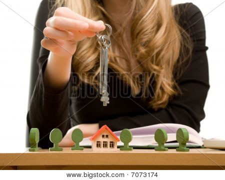 Woman's Hands With Key And Toy House