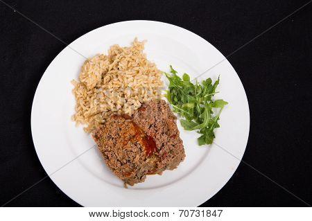 Meatloaf Rice And Arugula On Black