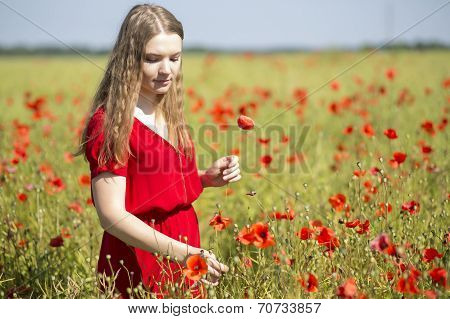 Woman  At Red Dress With Scarlet Poppy