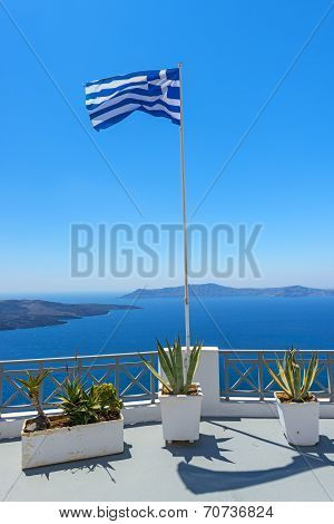 Waving Greek Flag In Santorini