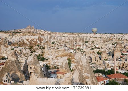 GOREME, TURKEY - JULY 30, 2007: Balloon over the Goreme in a summer morning. Hot air balooning over the Cappadocia landscape is a lovely leisure activity for tourists