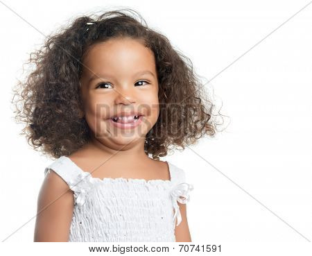 Little girl with an afro hairstyle smiling and wearing a white dress isolated on white