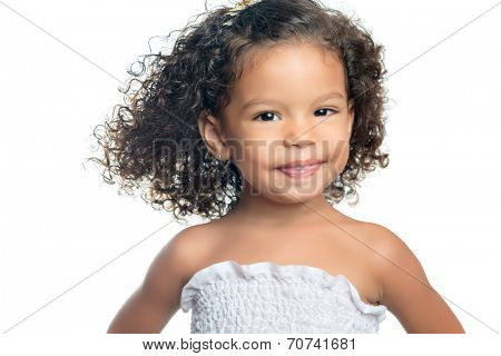 Cute ethnic little girl with an afro hairstyle isolated on white