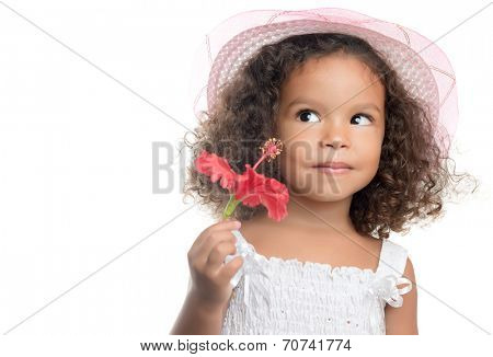 Little girl with an afro hairstyle holding a red flower with a smile (isolated on white)
