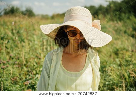Beautiful woman in hat with wide brim
