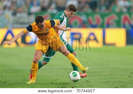 VIENNA, AUSTRIA - AUGUST 8 Christos Pipinis (#3 Asteras) and Marcel Sabitzer (#24 Rapid) fight for the ball at a UEFA Europa League game on August 8, 2013 in Vienna, Austria.