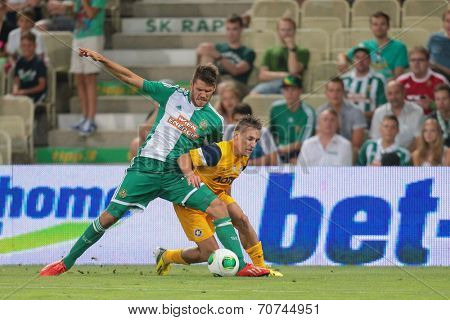 VIENNA, AUSTRIA - AUGUST 8 Christopher Trimmel (#28 Rapid) and Pablo de Blasis (#32 Asteras) fight for the ball at a UEFA Europa League game on August 8, 2013 in Vienna, Austria.