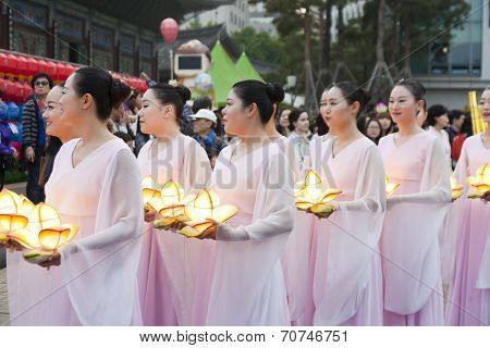 SEOUL KOREA MAY 12: People are performing folk dance for celebration of Lotus Lantern Festival on the street in front of Jogyesa Temple on may 12 2013, Seoul, Korea.