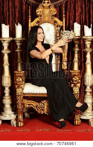 Sexy woman sitting on throne